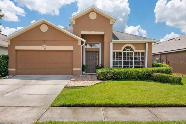 14200 Sunriver Avenue, Orlando, FL 32828 (MLS #O5800148) :: Premium Properties Real Estate Services