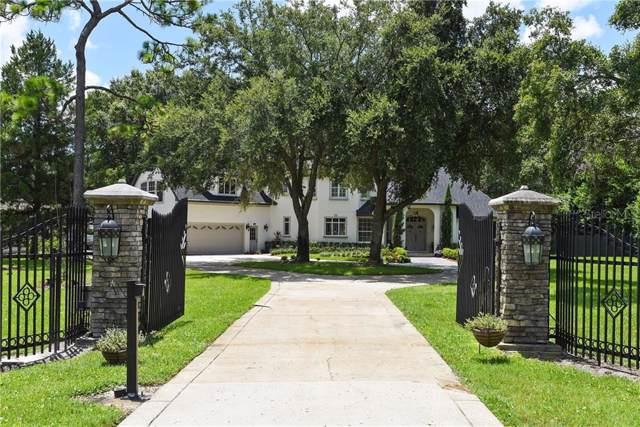 8734 Palm Lake Drive, Orlando, FL 32819 (MLS #O5800716) :: Griffin Group