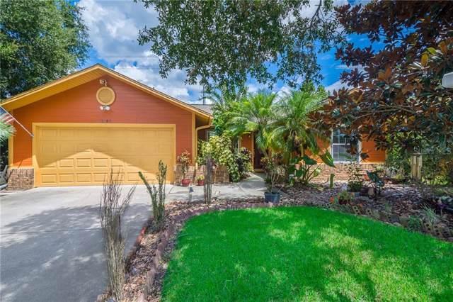 10143 Chesham Drive, Orlando, FL 32817 (MLS #O5807842) :: NewHomePrograms.com LLC