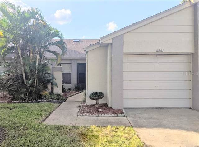 12267 Augusta Woods Circle, Orlando, FL 32824 (MLS #O5819959) :: Young Real Estate
