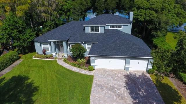 9802 Lake Georgia Drive, Orlando, FL 32817 (MLS #O5823469) :: Griffin Group