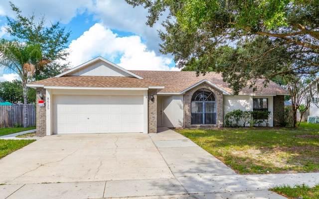 8615 Grandee Drive, Orlando, FL 32829 (MLS #O5824978) :: 54 Realty