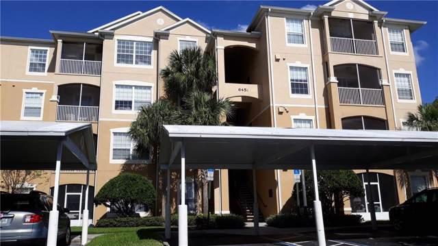 6451 Old Park Lane #210, Orlando, FL 32835 (MLS #O5825641) :: Griffin Group