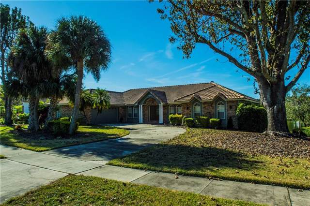 8556 Lost Cove Drive, Orlando, FL 32819 (MLS #O5827638) :: Gate Arty & the Group - Keller Williams Realty Smart