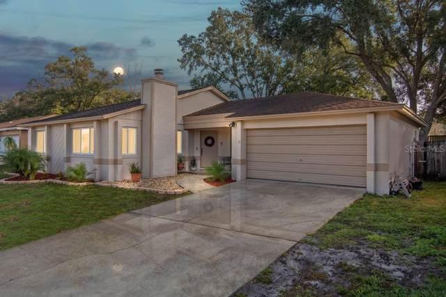 8423 Bay Oak Court, Orlando, FL 32810 (MLS #O5838563) :: Team Bohannon Keller Williams, Tampa Properties