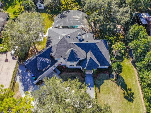 8734 Palm Lake Drive, Orlando, FL 32819 (MLS #O5839650) :: Delgado Home Team at Keller Williams