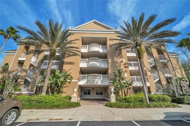 7651 Whisper Way #102, Reunion, FL 34747 (MLS #O5847369) :: Gate Arty & the Group - Keller Williams Realty Smart