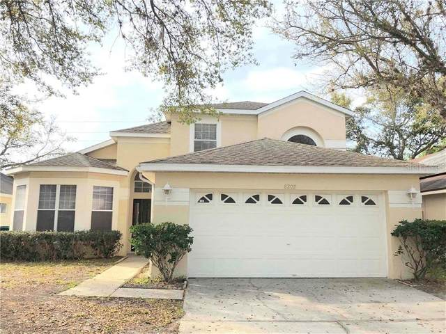8202 Woodsworth Drive, Orlando, FL 32817 (MLS #O5852699) :: Homepride Realty Services