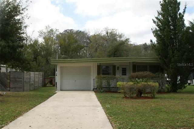 13349 Woodland Drive, Astatula, FL 34705 (MLS #O5862913) :: The Duncan Duo Team