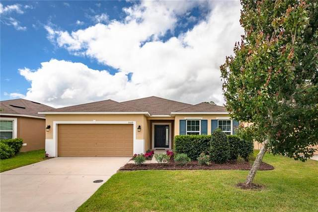 5009 Grassy Knoll Drive, Tavares, FL 32778 (MLS #O5864720) :: Griffin Group