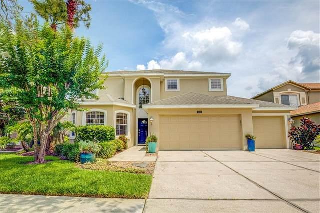 2455 Ridgemoor Drive, Orlando, FL 32828 (MLS #O5868119) :: The Price Group