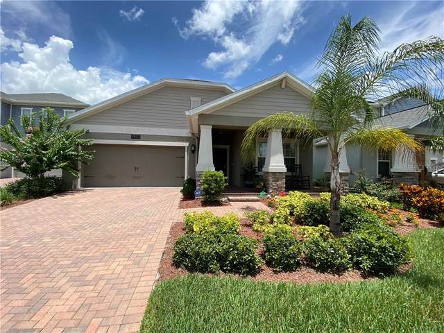 9953 Magnolia Woods Boulevard, Orlando, FL 32832 (MLS #O5875770) :: The Light Team