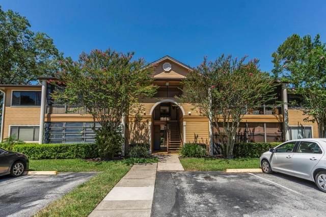6025 Scotchwood Glen #102, Orlando, FL 32822 (MLS #O5883697) :: Armel Real Estate