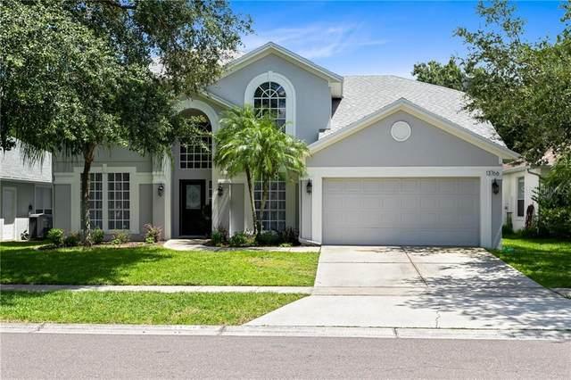 13766 Blue Lagoon Way, Orlando, FL 32828 (MLS #O5883985) :: Griffin Group