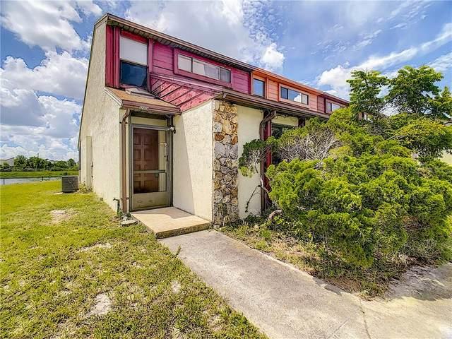 12338 Fox Hound Lane #25, Orlando, FL 32826 (MLS #O5886252) :: Florida Life Real Estate Group