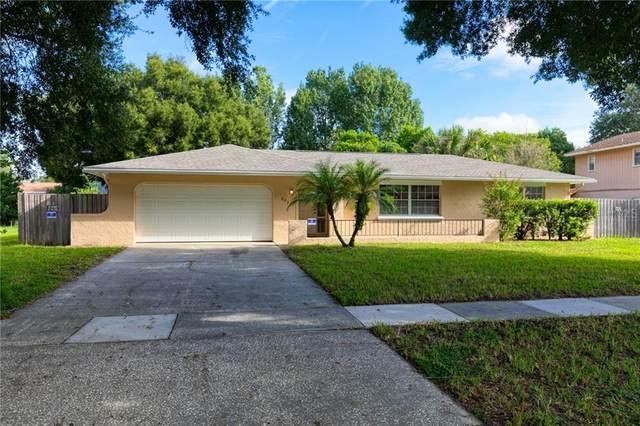 8029 Sandberry Boulevard, Orlando, FL 32819 (MLS #O5892683) :: RE/MAX Premier Properties