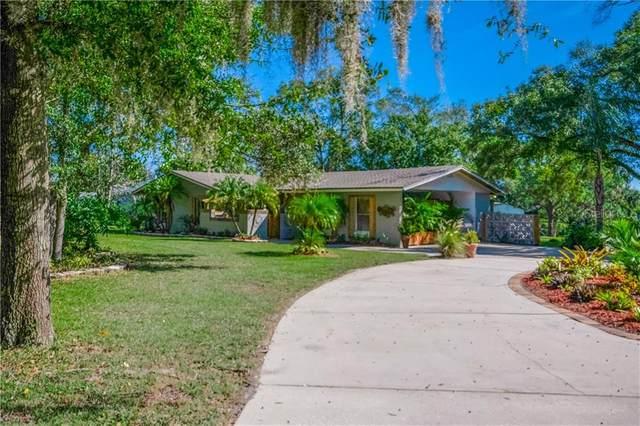 7418 Lake Marsha Drive, Orlando, FL 32819 (MLS #O5907101) :: Frankenstein Home Team