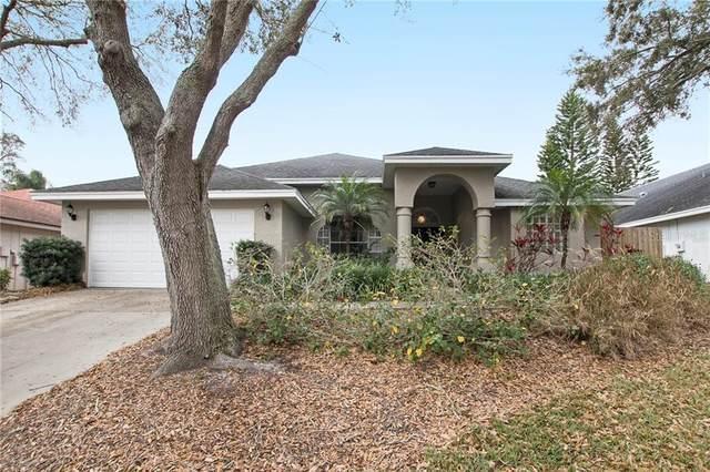 1714 Polo Club Drive, Tarpon Springs, FL 34689 (MLS #O5925972) :: Heckler Realty