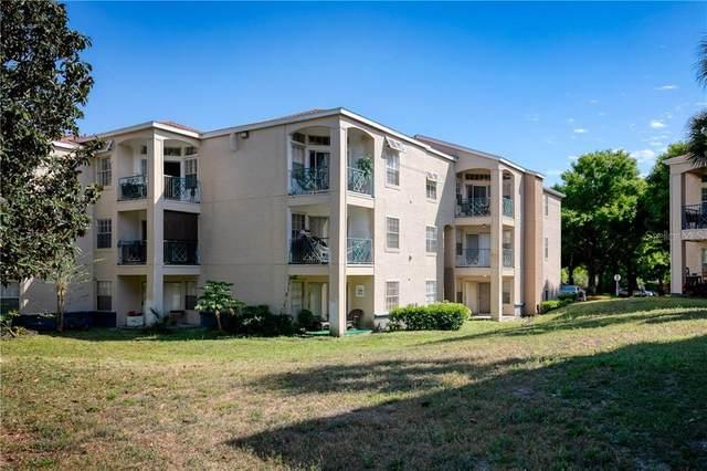 7230 Westpointe Boulevard #1233, Orlando, FL 32835 (MLS #O5931948) :: Visionary Properties Inc
