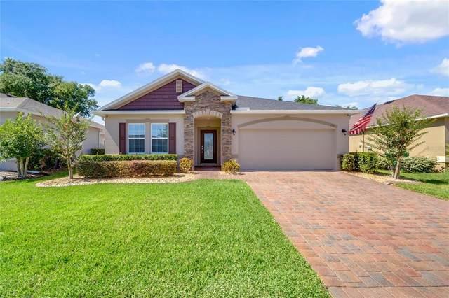 153 W Fiesta Key Loop, Deland, FL 32720 (MLS #O5942711) :: Bob Paulson with Vylla Home