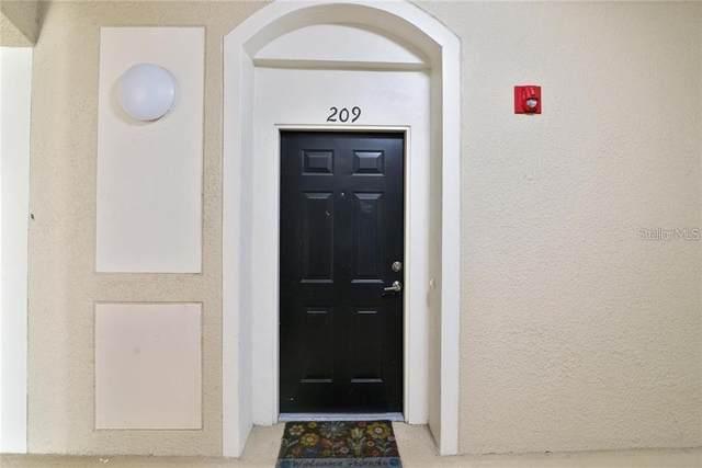 6434 Cava Alta Drive #209, Orlando, FL 32835 (MLS #O5945047) :: Baird Realty Group