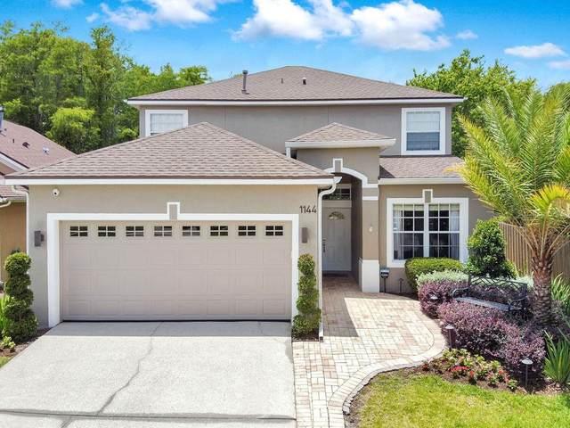 1144 Royal Saint George Drive, Orlando, FL 32828 (MLS #O5949114) :: Everlane Realty