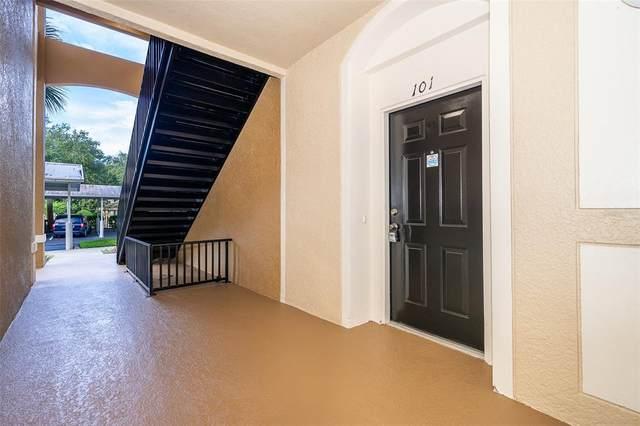 6451 Old Park Lane #101, Orlando, FL 32835 (MLS #O5951802) :: Young Real Estate