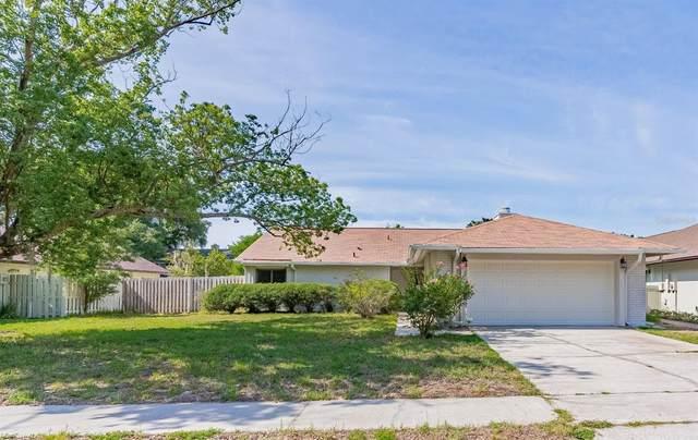 8304 Helena Drive, Orlando, FL 32817 (MLS #O5952826) :: GO Realty