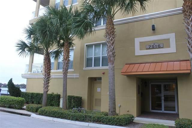 7516 Toscana Boulevard #211, Orlando, FL 32819 (MLS #O5953547) :: Tuscawilla Realty, Inc