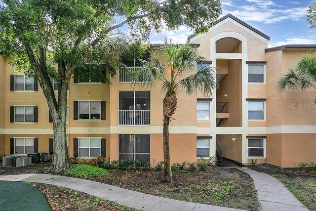 7606 Pissarro Drive #104, Orlando, FL 32819 (MLS #O5956362) :: Tuscawilla Realty, Inc