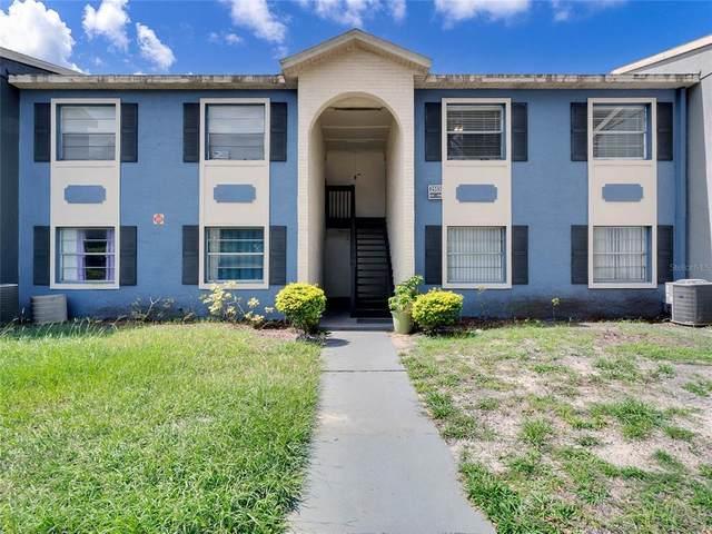 2553 North Alafaya Trail #104, Orlando, FL 32826 (MLS #O5958667) :: Bob Paulson with Vylla Home
