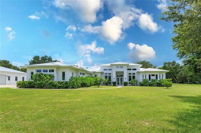 5897 Club Drive, Groveland, FL 34736 (MLS #O5962720) :: Globalwide Realty