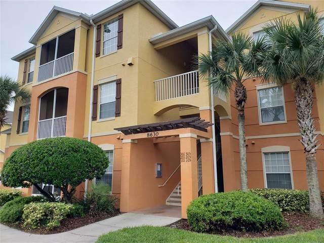 8630 Buccilli Drive #302, Orlando, FL 32829 (MLS #O5963106) :: Expert Advisors Group