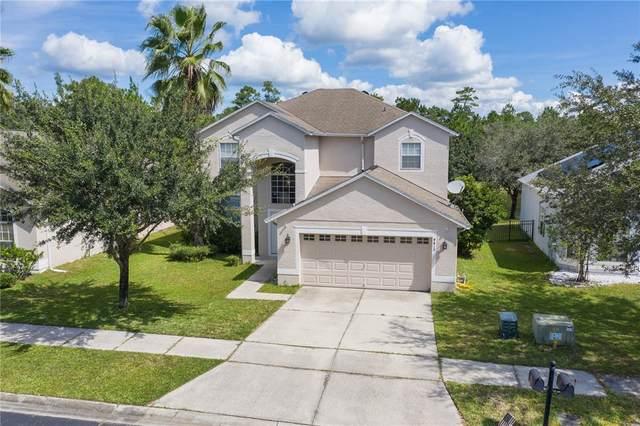 4819 Aguila Place, Orlando, FL 32826 (MLS #O5971680) :: Prestige Home Realty