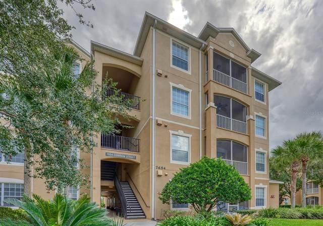 7654 Comrow Street #401, Kissimmee, FL 34747 (MLS #O5974104) :: Everlane Realty