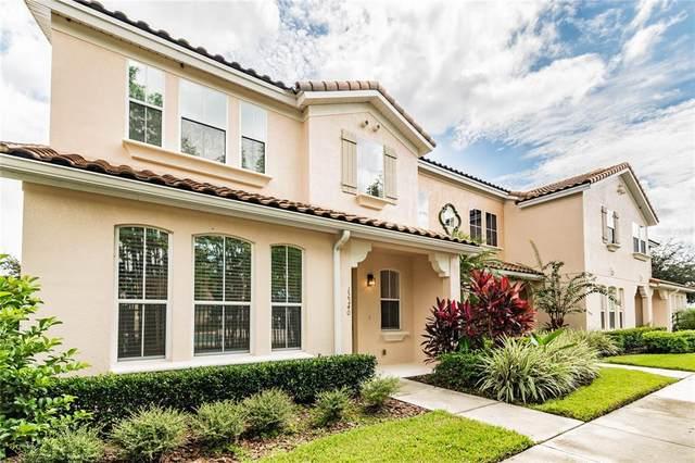 12240 Triton Lane #7, Orlando, FL 32837 (MLS #O5974122) :: Everlane Realty