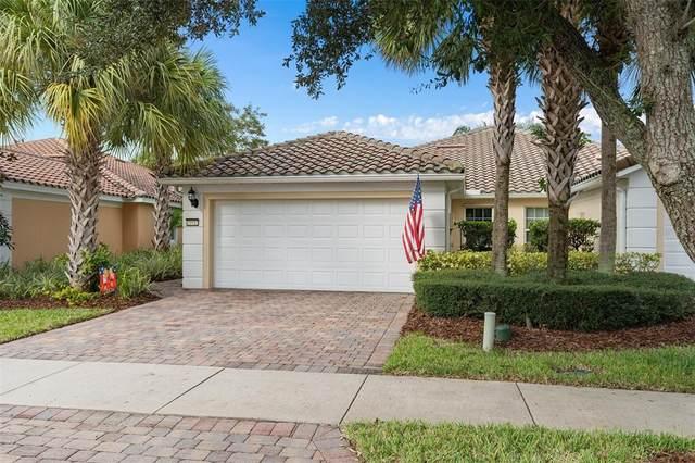 11932 Iselle Drive, Orlando, FL 32827 (MLS #O5975568) :: CARE - Calhoun & Associates Real Estate