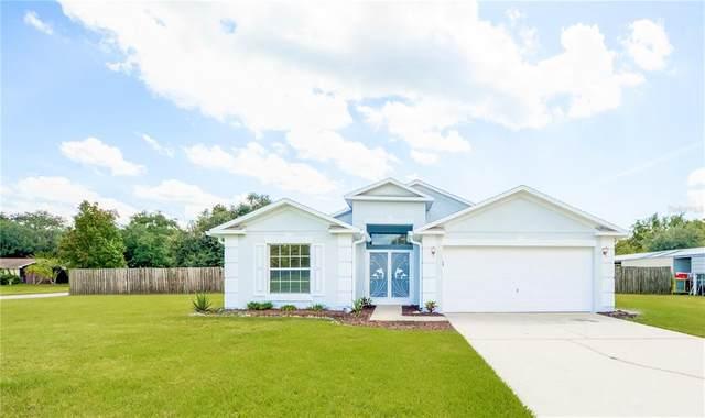 1820 Kings Point Boulevard, Kissimmee, FL 34744 (MLS #O5975629) :: CARE - Calhoun & Associates Real Estate