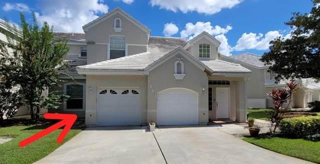 7003 Della Drive #2, Orlando, FL 32819 (MLS #O5980205) :: Everlane Realty