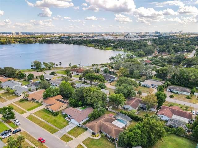 7046 Delora Drive, Orlando, FL 32819 (MLS #O5980414) :: The Truluck TEAM