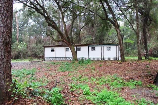 303 SE 130TH Terrace, Gainesville, FL 32641 (MLS #OM600504) :: Team Borham at Keller Williams Realty