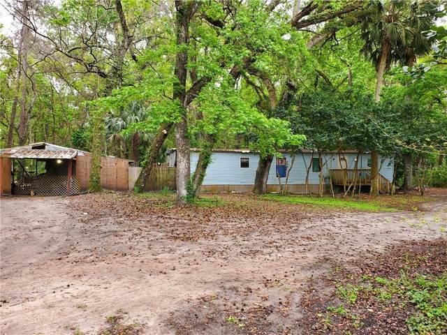9525 SE Highway 464C, Ocklawaha, FL 32179 (MLS #OM617275) :: Vacasa Real Estate