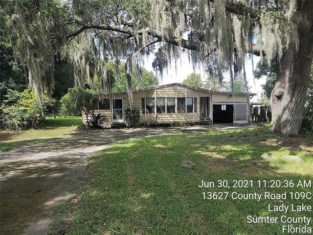 8261 County Road 109, Lady Lake, FL 32159 (MLS #OM622939) :: Kreidel Realty Group, LLC