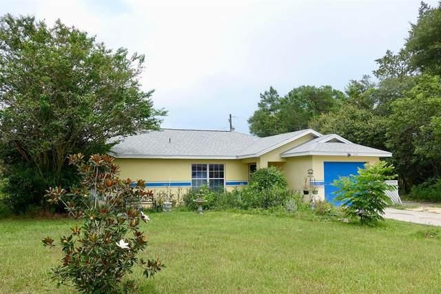 335 Marion Oaks Lane, Ocala, FL 34473 (MLS #OM625063) :: Everlane Realty