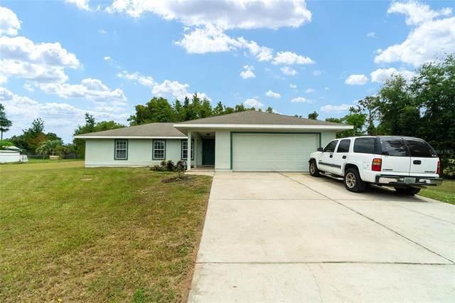 10365 SE 148TH Street, Summerfield, FL 34491 (MLS #OM626073) :: Gate Arty & the Group - Keller Williams Realty Smart