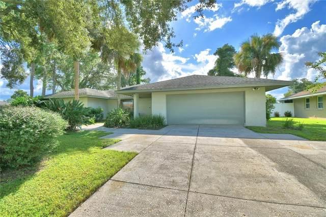 2135 Edgewater Circle, Winter Haven, FL 33880 (MLS #P4917483) :: Everlane Realty
