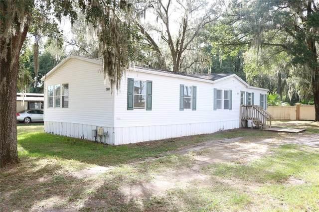 6941 Sylvan Lane, Zephyrhills, FL 33541 (MLS #P4918010) :: Griffin Group