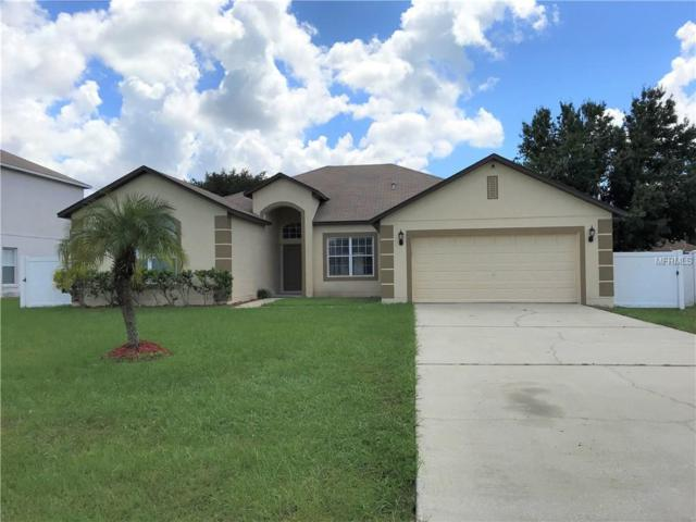 904 Cannes Drive, Kissimmee, FL 34759 (MLS #S5007010) :: The Duncan Duo Team