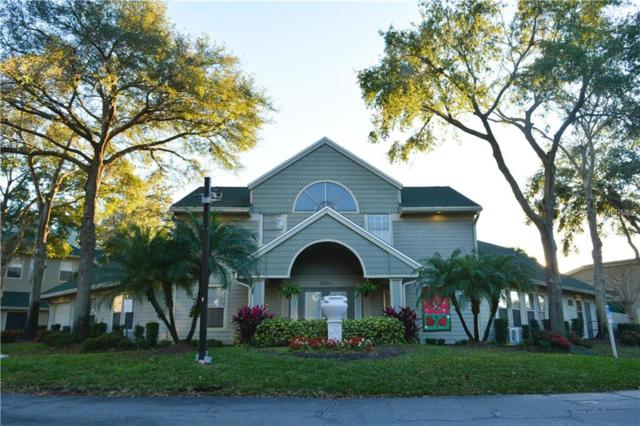 5992 Westgate Drive #103, Orlando, FL 32835 (MLS #S5011885) :: Bustamante Real Estate