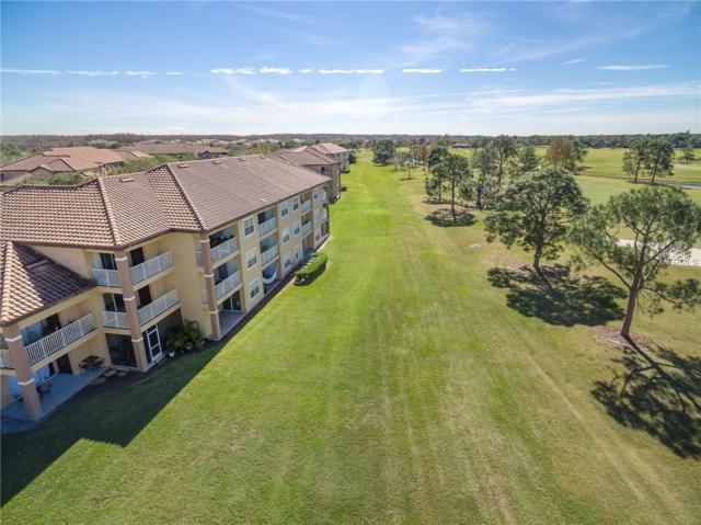 13905 Fairway Island Drive #1027, Orlando, FL 32837 (MLS #S5012335) :: Griffin Group